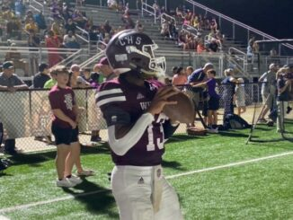 Central QB Jonathan Swift II warming up at halftime during the game again Belaire
