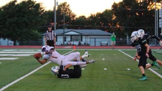 Wesley Fair from Wichita Collegiate School in Wichita, Kansas diving for the end zone while bring tackled