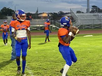 ATHs Lecoreyan Compton (left) and Denichlass Jeter (right) warming up for their game against Plaquemine