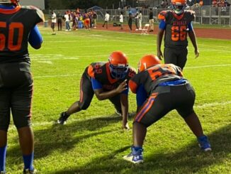 Belaire's OL and DL lining up for individual practice before the game vs. St. Michael